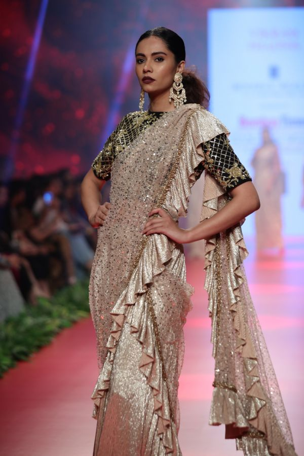 Gold Frill Drape Saree with Black and Gold Embroidered Blouse